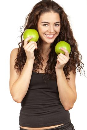 beautiful brunette holding apples apples